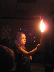 child-holding-candle