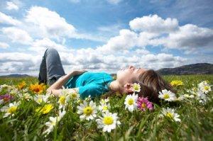 girl-resting-in-meadow