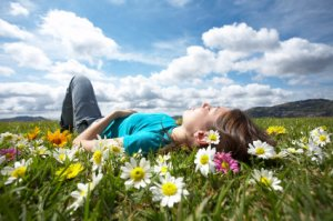 girl-resting-in-meadow