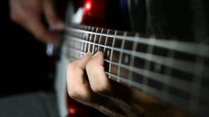 stock-footage-bass-guitar-player-close-up-playing-virtuoso-bass-with-fingers