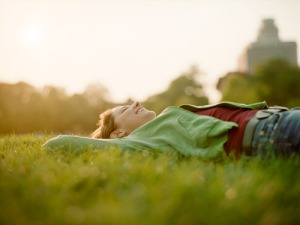 Girl lying in grass laughing